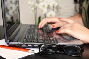 person-woman-desk-laptop-large-min